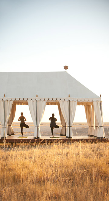 San Camp-Classic White Tented Safari Style in front of a massive Salt Pan
